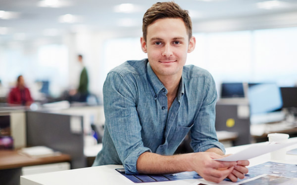 Man standing at desk in office