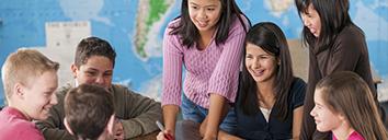 Six school children practising English with their teacher